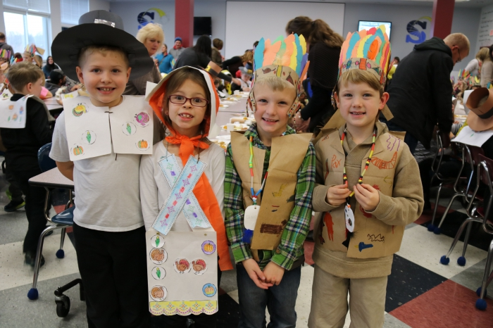Gage Ward, Jaz McGrath, Chace Lasell and Paxton Roberts pose following the annual Thanksgiving Feast at Sandy Creek Elementary School. The first and second graders host their own take on Thanksgiving, complete with lots of singing and of course, feasting.